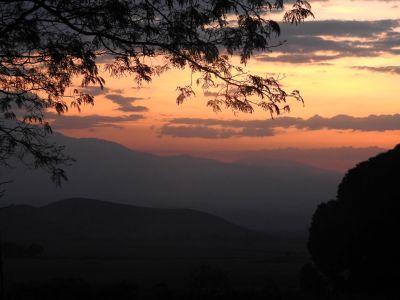 Genieten van de zonsondergang vanaf onze veranda